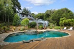 Crisp pool and bubbling hot tub where you can have your pool parties.